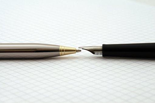 A ballpoint and fountain pen