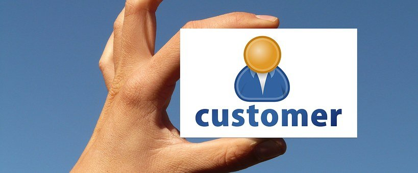 A white card held up with a bust and the word customer to signify one player in affiliate marketing