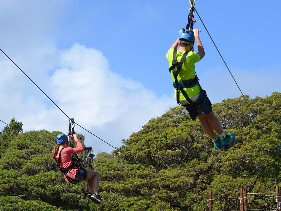 A guy and a girl ziplining