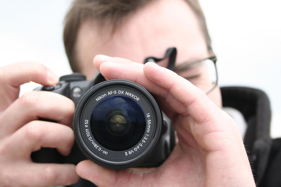 camera taking photo photographer free photo on pixabay