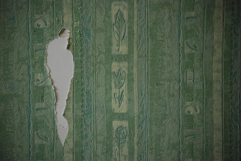 hole wallpaper torn wallpaper