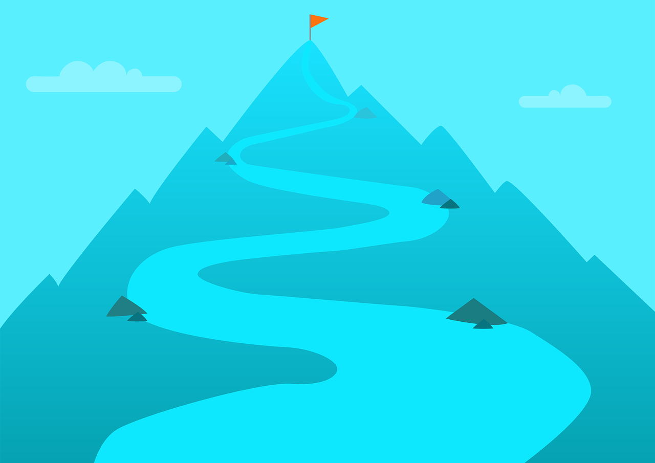 A blue outline of a mountain stands against a blue sky dotted with clouds. A wiggly path leads from the front of the image to the top of the mountain, where a red flag on a flagpole is placed.