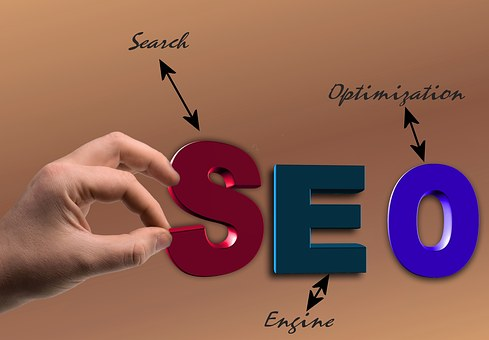 A hand picking the S in the SEO with arrows giving their signifcations