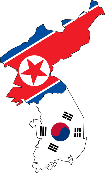 National flags of North and South Korea, inside each country's geographic outline.