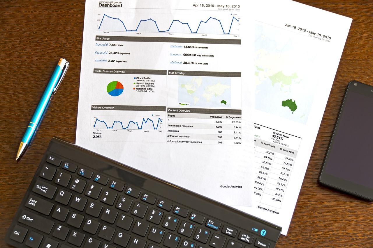 SEO insight report on paper beside keyboard
