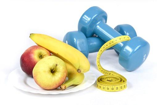A Photo Of A Banana, Apples And Also Some Weights. Your Answer To Why Am I So Fat? Diet And Exercise.