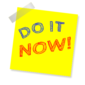 A yellow sticker saying DO IT NOW! the first two words in blue and the last in red
