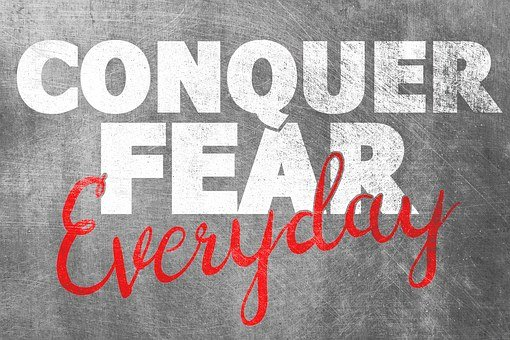 Conquer fear everyday painted on a blackboard for 301 inspirational and motivational quotes
