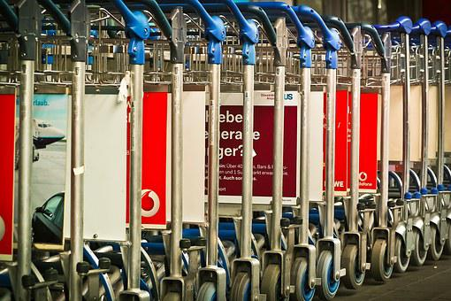 row of luggage carts in an airport