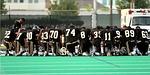 football team, praying, kneeling