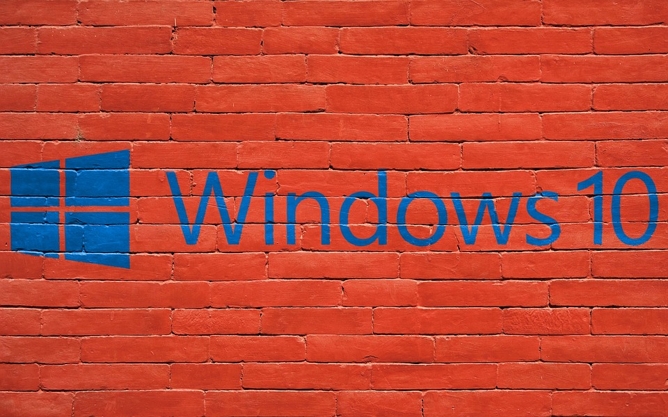 Photo of a windows 10 logo on a brick wall