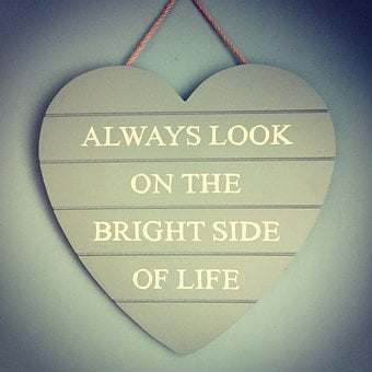 Wood cut into hear with wordfs Alawys look on the bright side of life for 301 inspirational and motivational quotes
