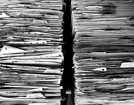 Files paper office paperwork stack