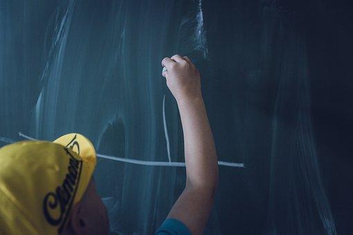 kid writing on the board