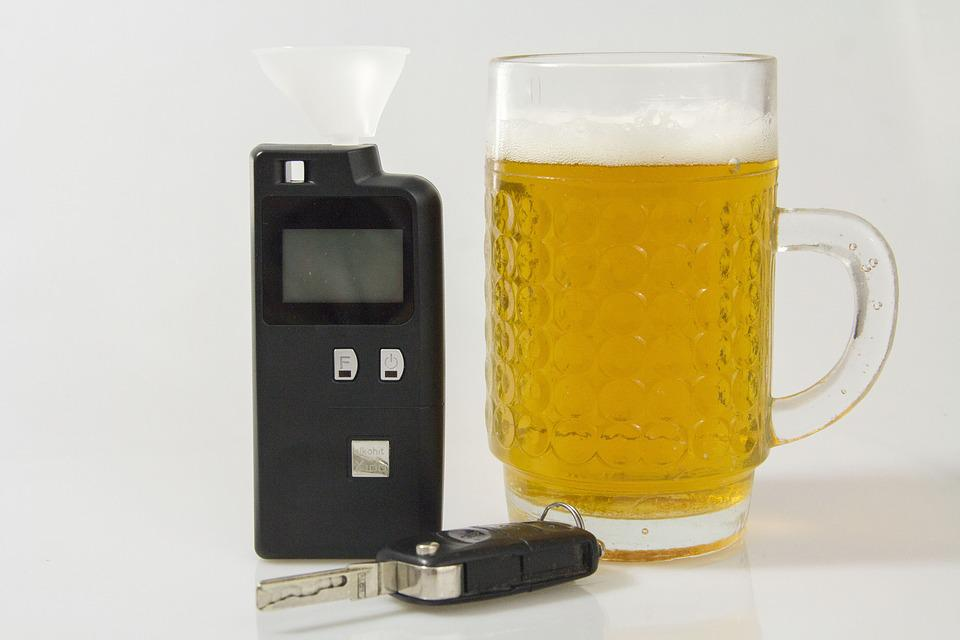 breathalyzer and a glass of alcohol