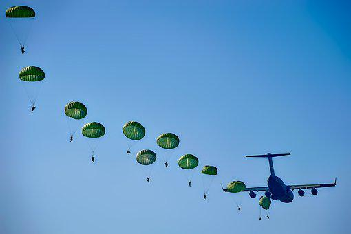 Parachutes coming out of a plane