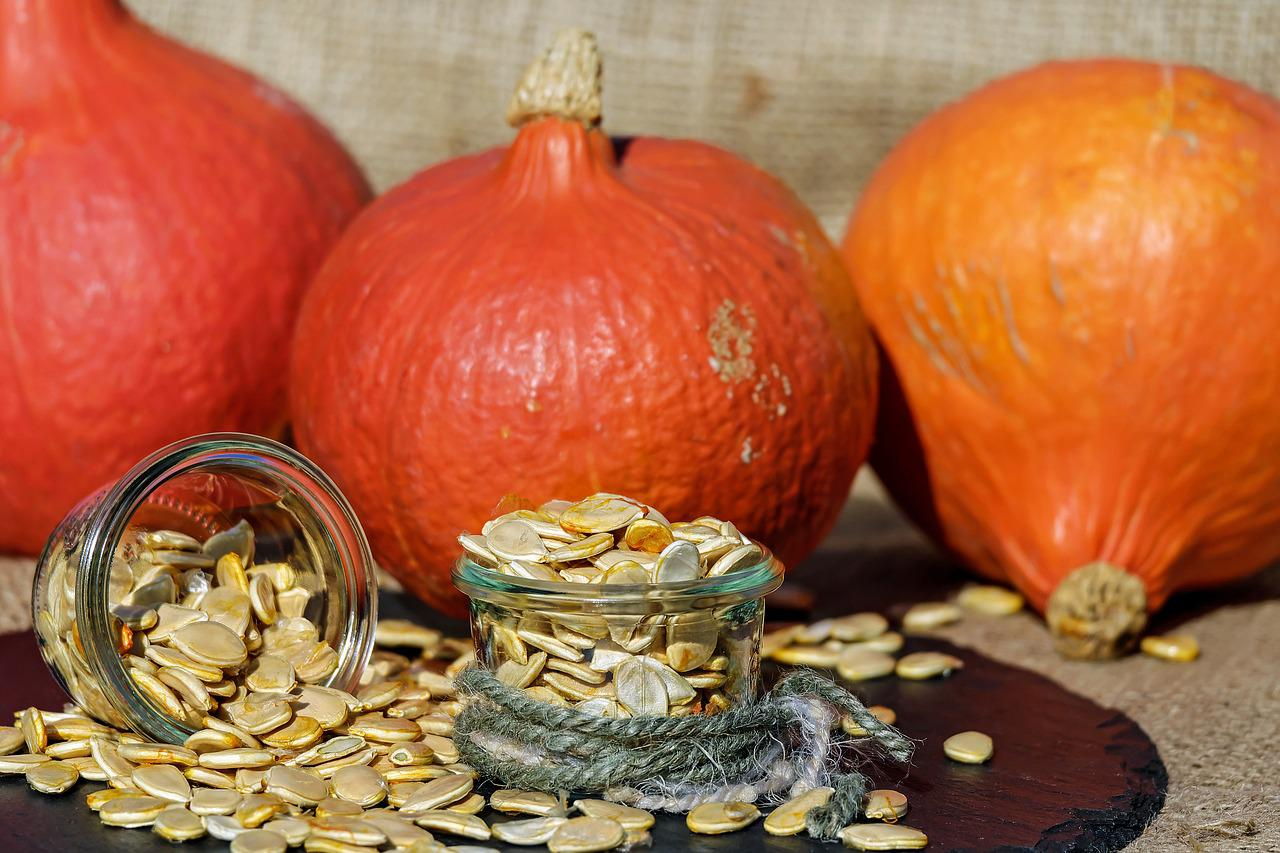 3 pumpkins with pumpkin seeds