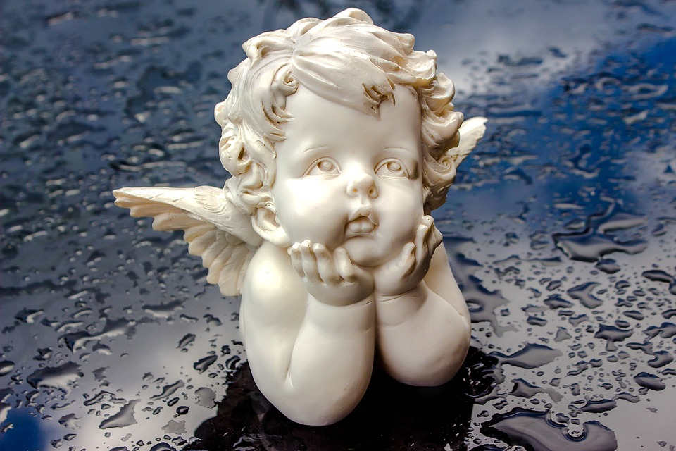 angel figure sitting head supportively