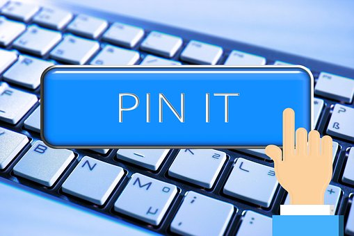 Hand with pin it written over keyboard as part of Online awareness creation 5: Pinterest