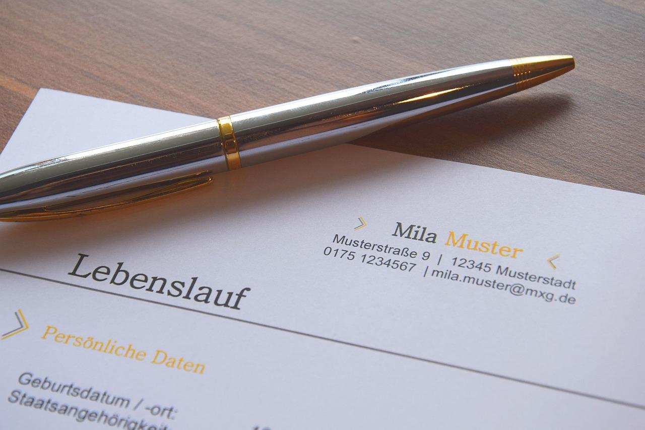 A silver pen on top of a paper