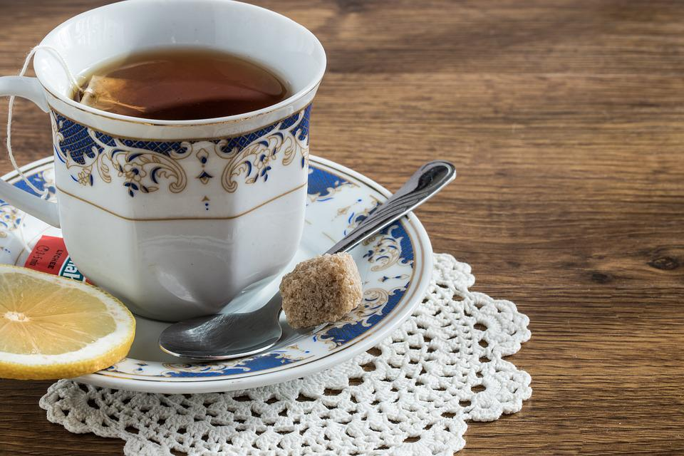 Tea cup on saucer with doily.