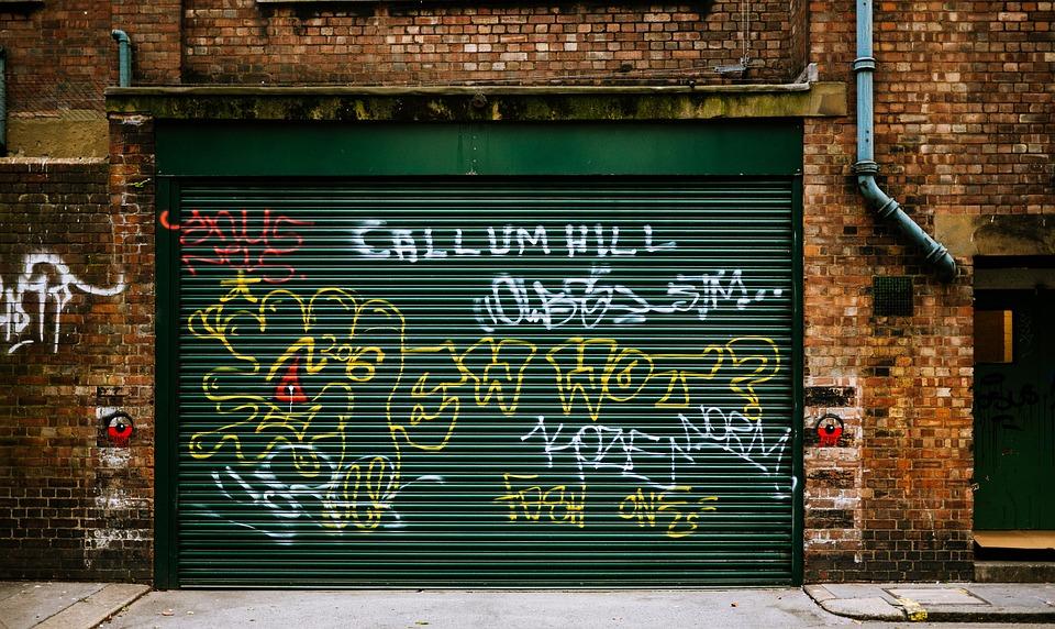 Graffiti on a green garage door