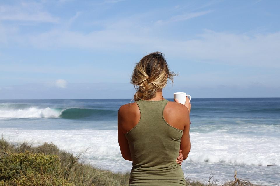 woman facing the ocean