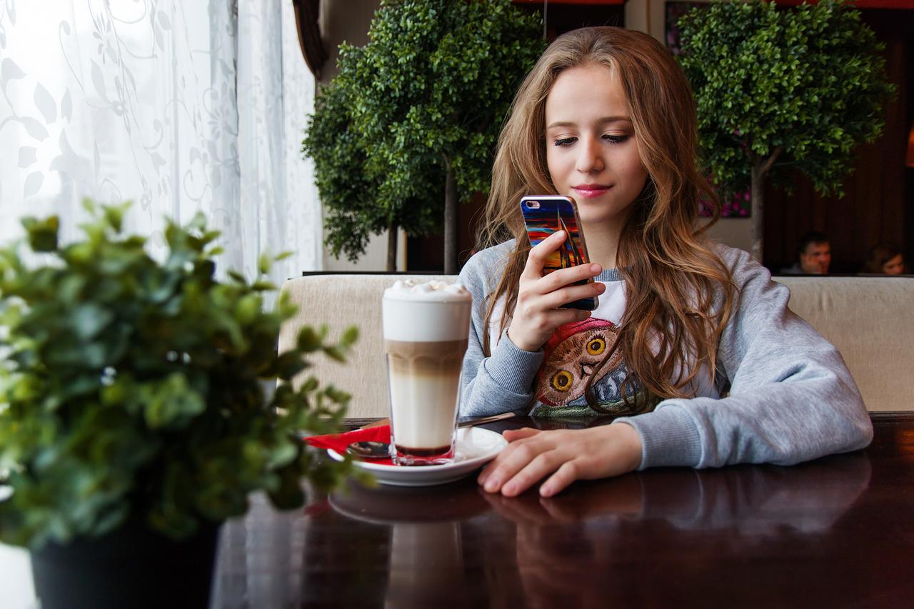 girl using the Internet in a coffee shop.