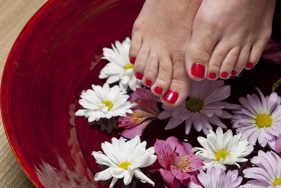 Photo of feet near a flowers