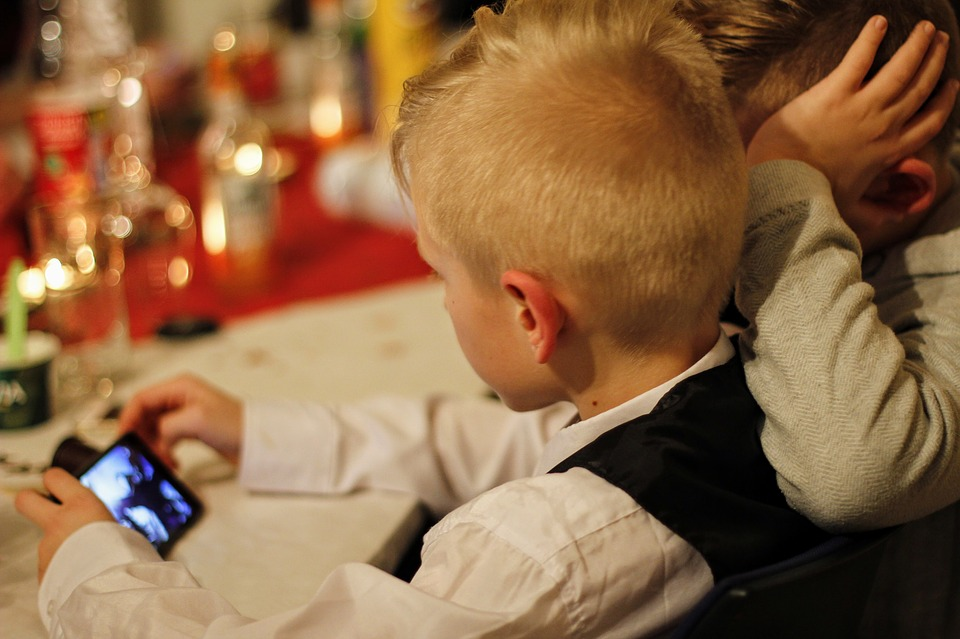 two kids playing on mobile game