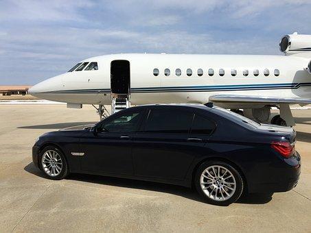 Classic car before private jet