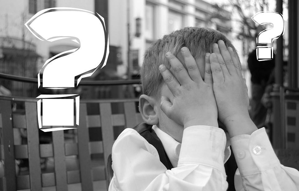 Photo of a boy near a question mark