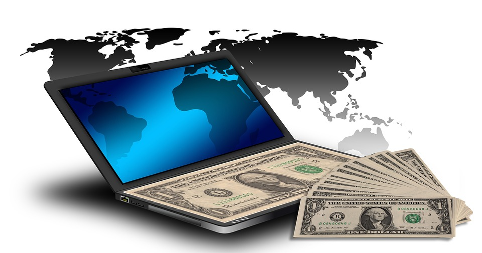 A picture of laptop and money to better elaborate Can Ecommerce make you/anybody rich? 2020
