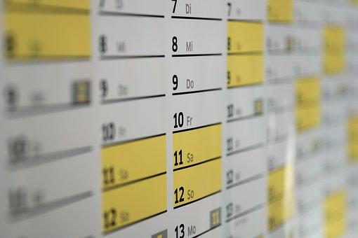 A wall calendar showing days and dates