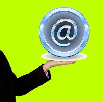 The email sign @ served on a plate by a waiter in black suit
