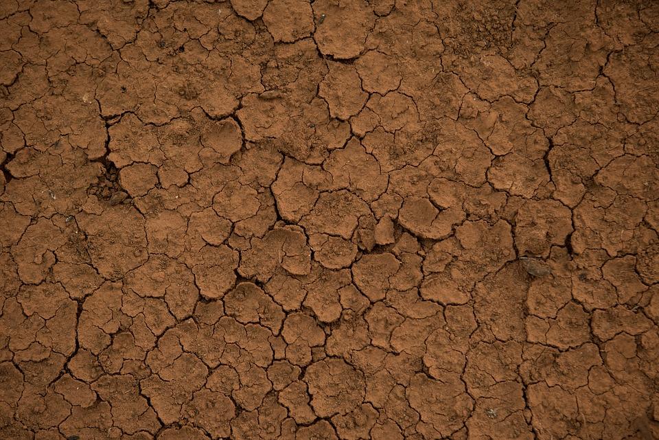 Foto gratis tierra textura barro rido seco imagen for Nivelar piso de tierra