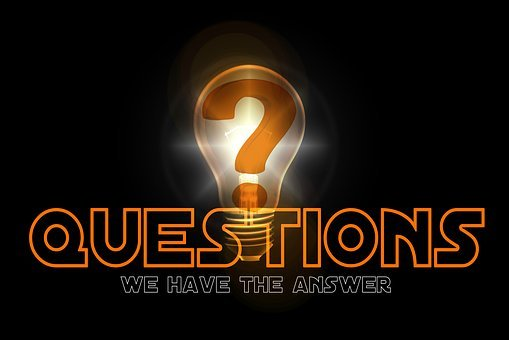 Drawing of a lit light bulb behind the word QUESTIONS and under it WE HAVE THE ANSWERS, all against a dark background