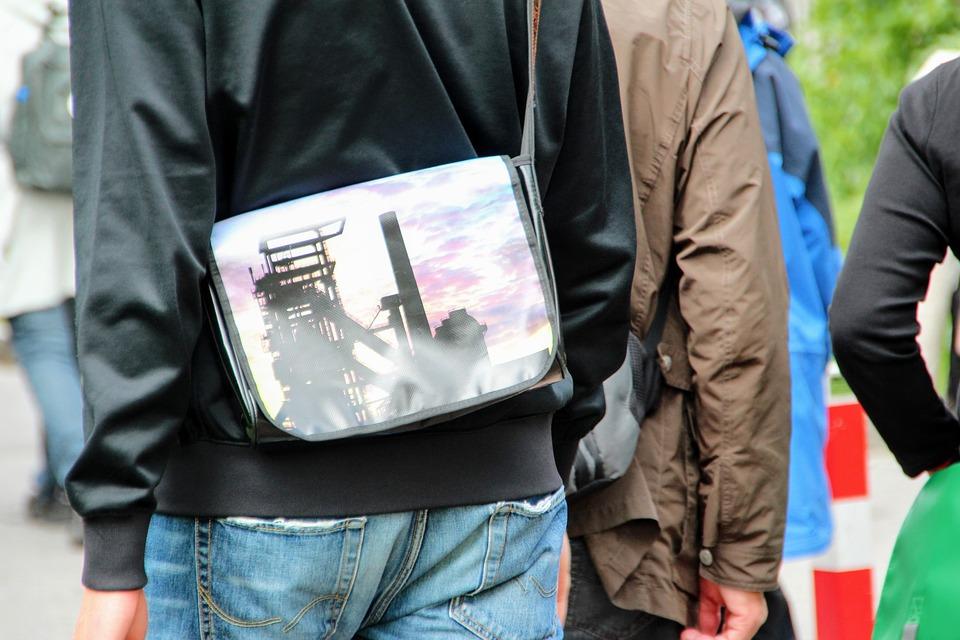 man wearing a sling bag