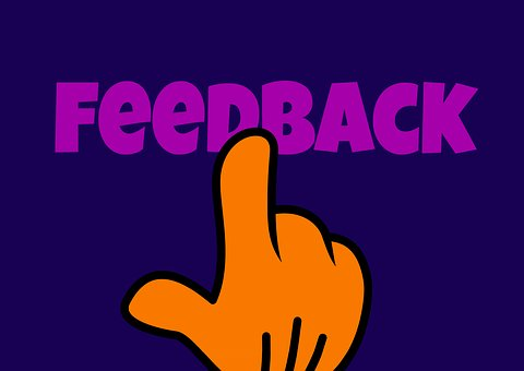 The word FEEDBACK written in violet over a blue background with a yellow finger pushing it like a button