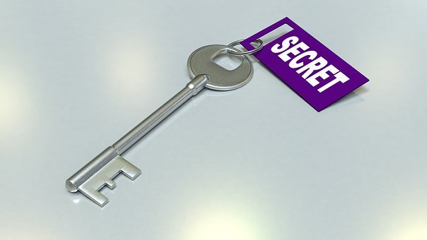 A key with the word SECRET attached