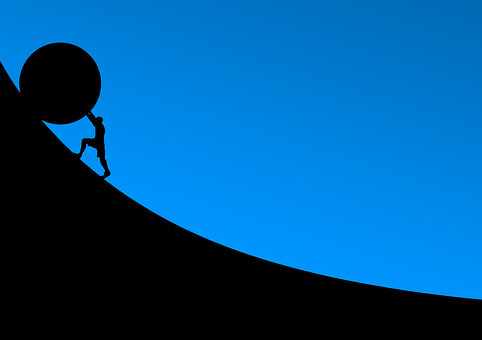 A man struggling to push a sphere up a steep hill to show struggling to succeed online