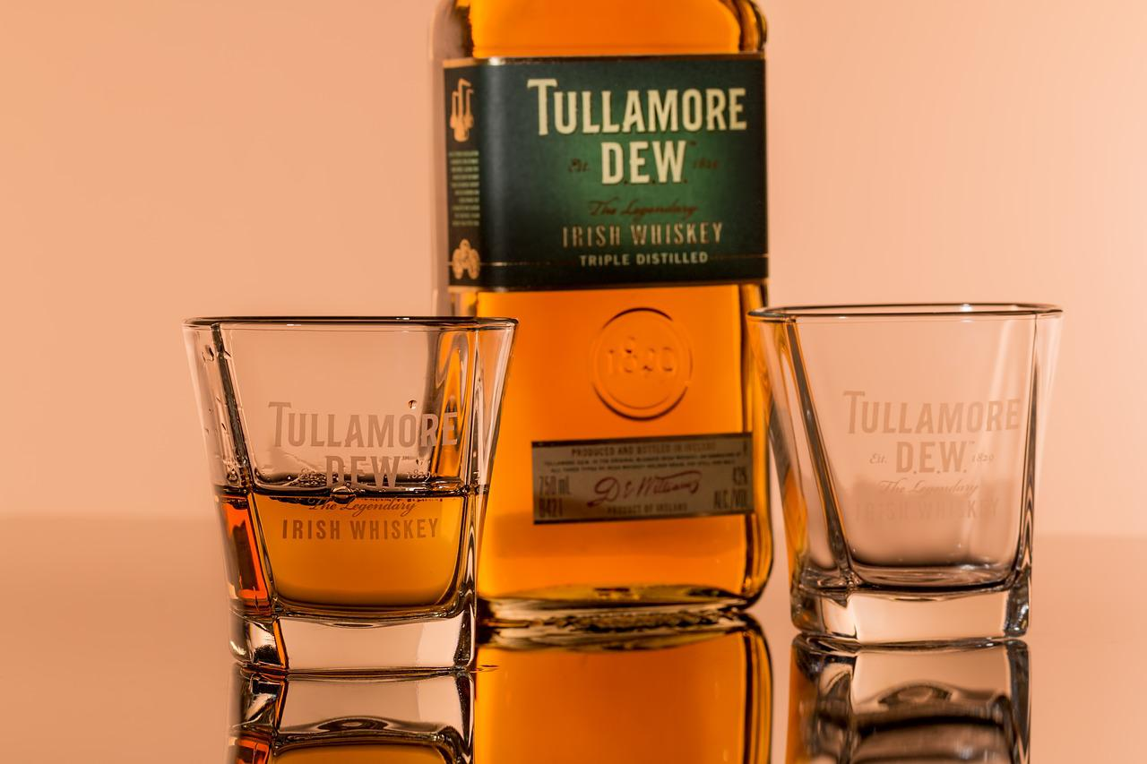 tullamore dew whiskey and two whiskey glasses; drinking games for couples