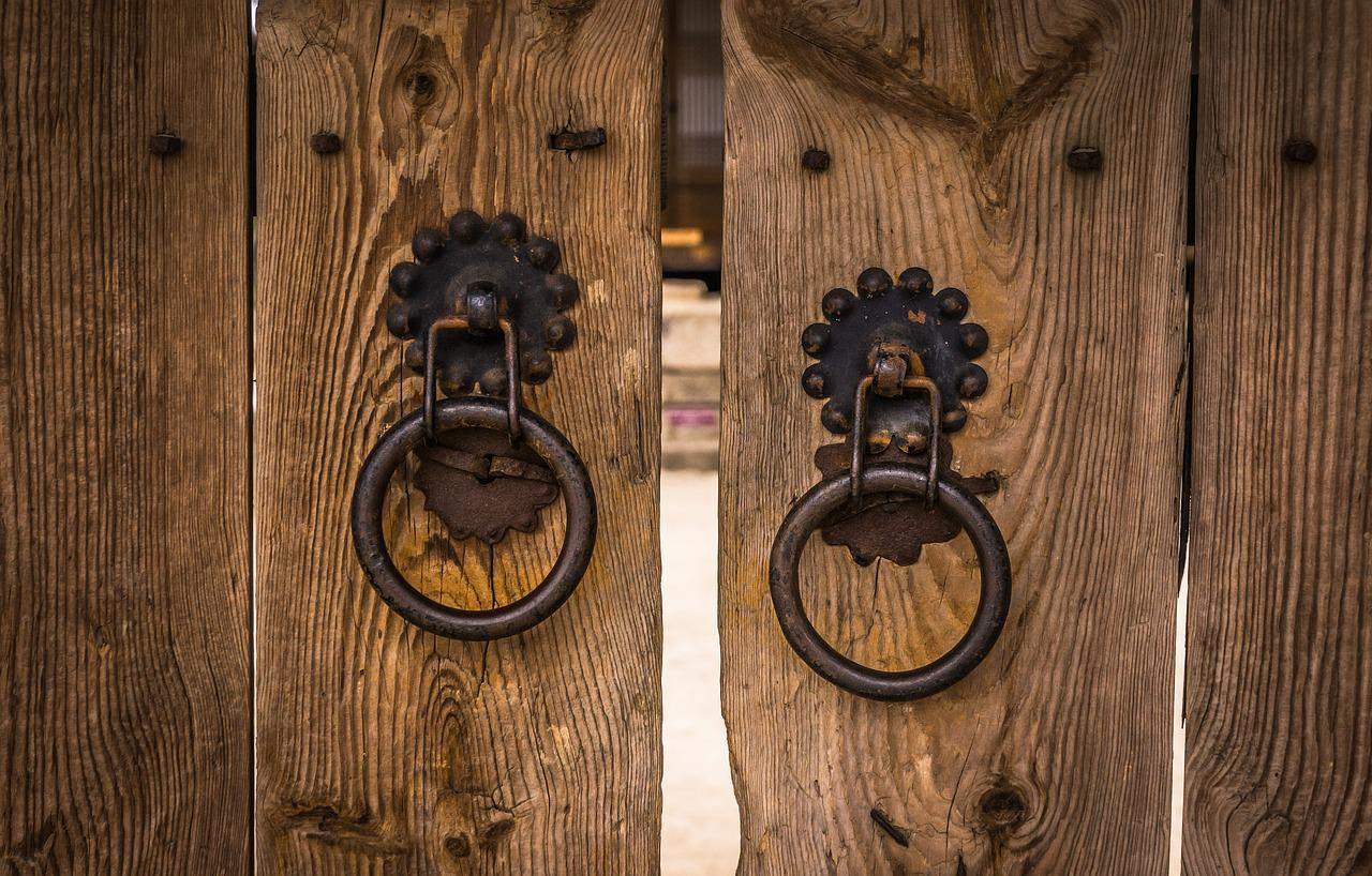 Traditional wooden doors with knockers in Bukchon Hanok Village, Seoul.