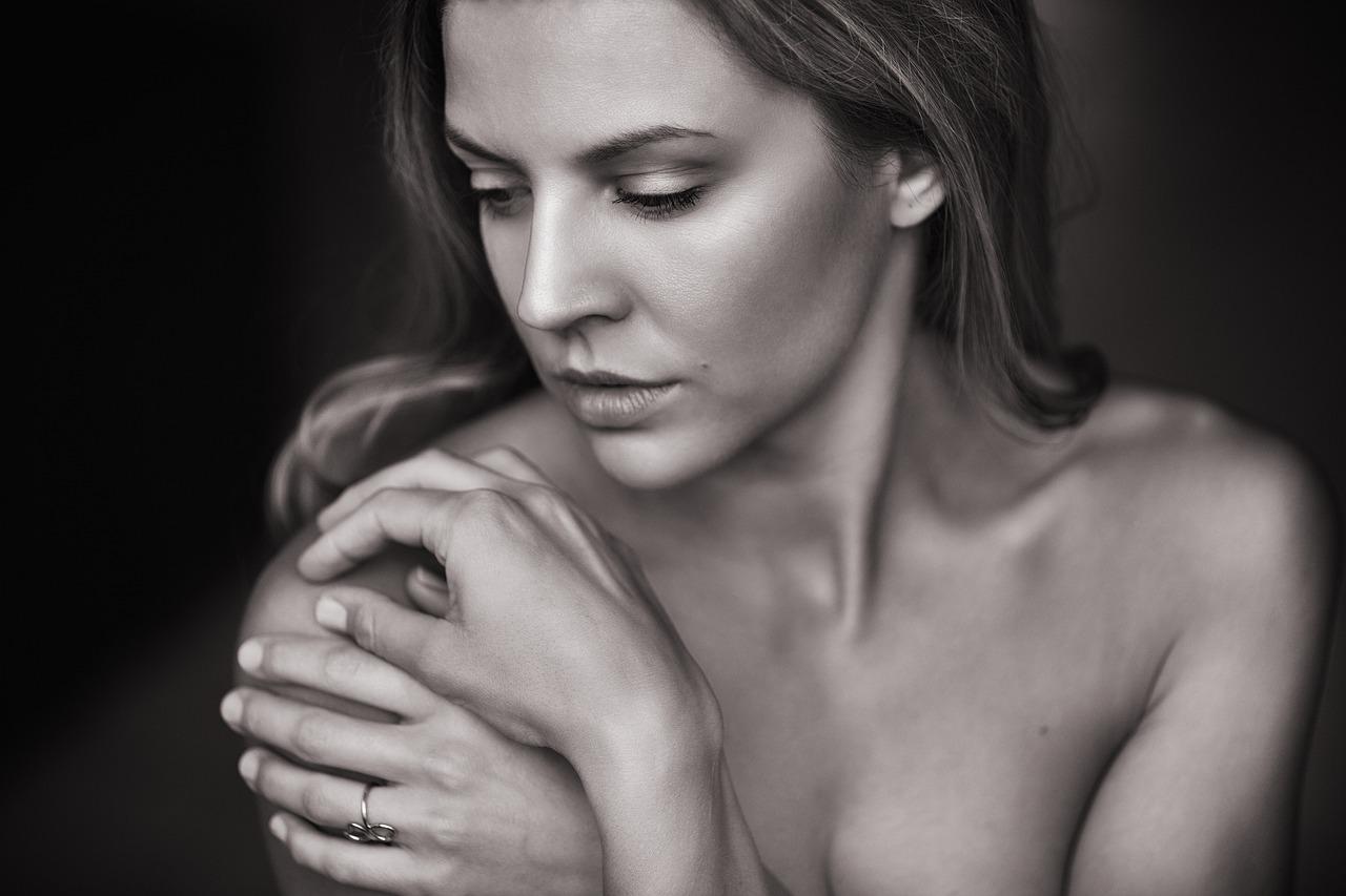 woman touching skin