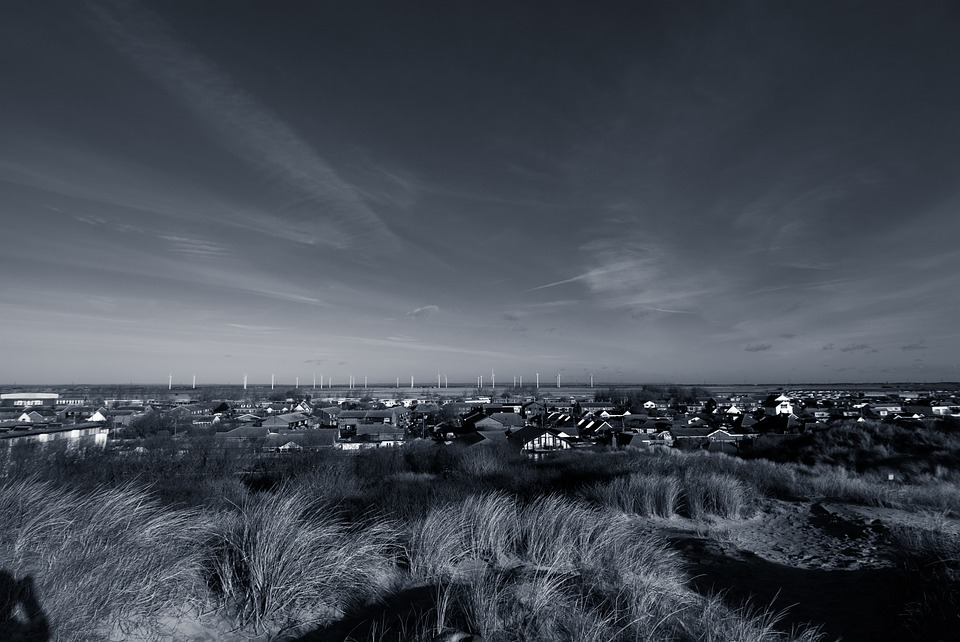 Uk beach sky black and white sand dunes town
