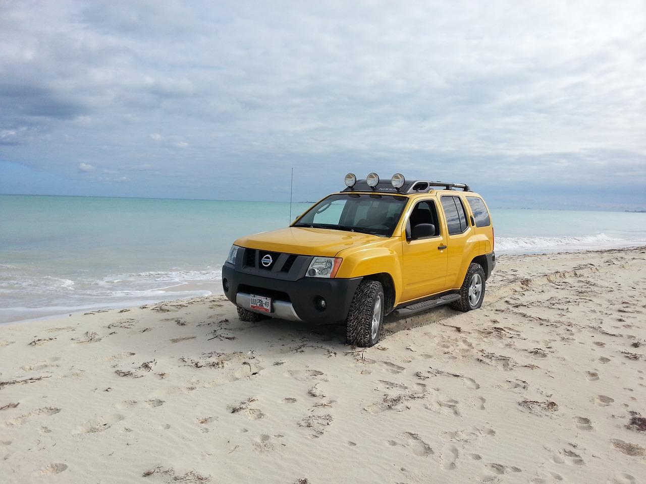 Yellow Xterra on the beach