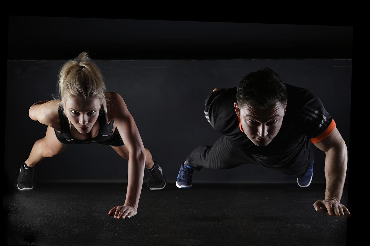 couple doing a one-hand push up