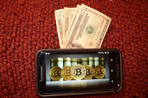 A case lined with bitcoins and dollar bills sticking out of the top, all against a bbordeau carpet.