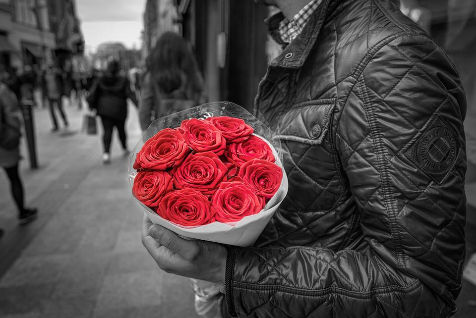 Holding red roses romance love man