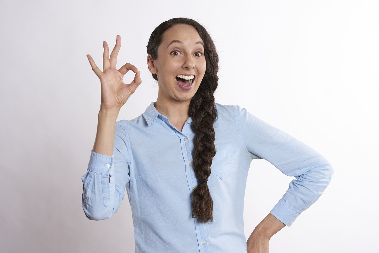 Woman making the OK gesture with her fingers.
